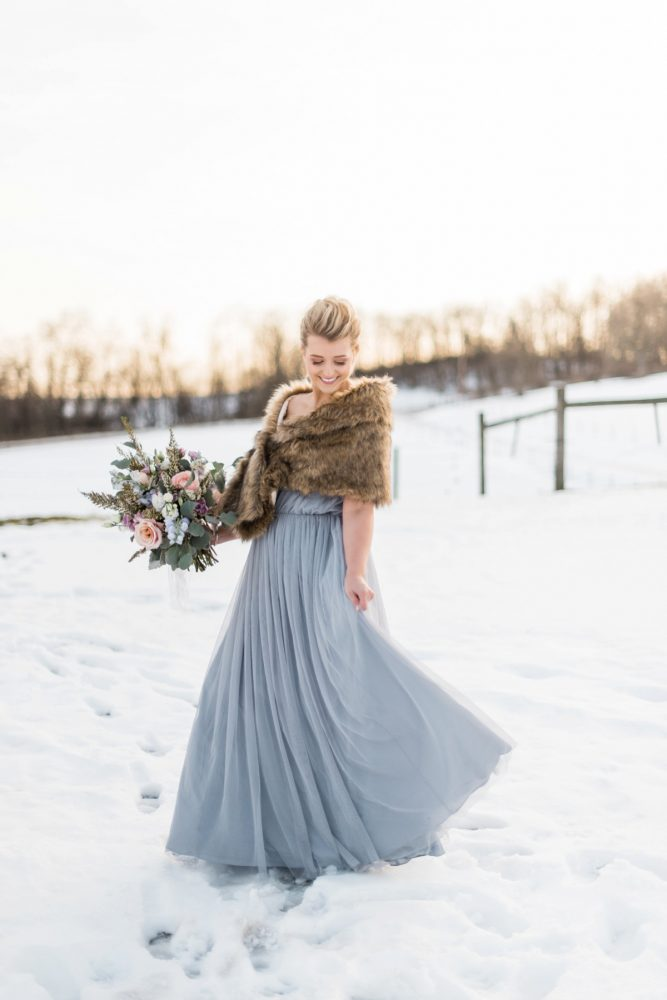 Bride in Ice Blue Wedding Dress and Faux Fur Wrap: Snowy Pastel Wedding Inspired Styled Shoot from Dawn Derbyshire Photography and Jessica Garda Events featured on Burgh Brides