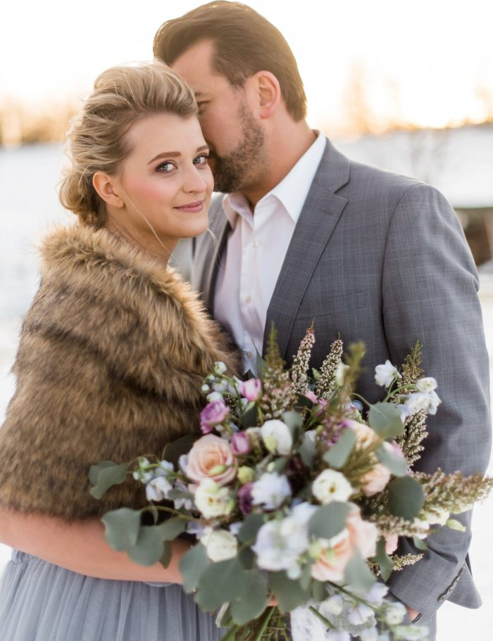 Faux Fur Wrap on Winter Bride in Blue Wedding Dress: Snowy Pastel Wedding Inspired Styled Shoot from Dawn Derbyshire Photography and Jessica Garda Events featured on Burgh Brides