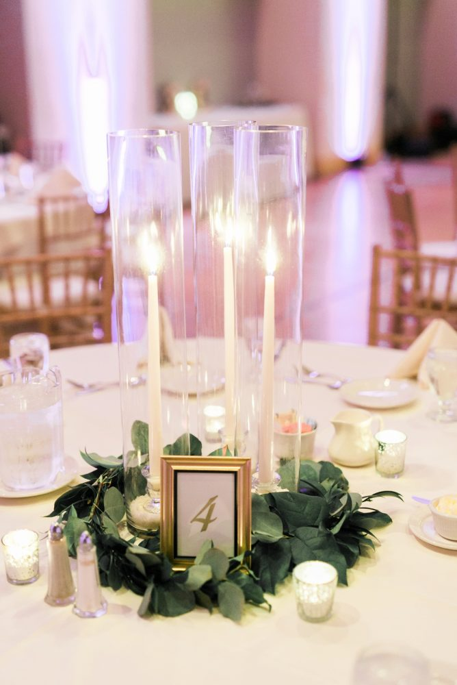 Taper Candles Wedding Centerpieces: Enchanting Greenery Inspired Wedding from Levana Melamed Photography featured on Burgh Brides