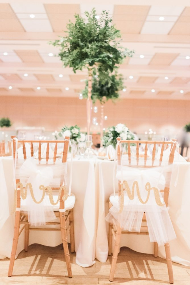 Wooden Mr and Mrs Chair Signs at Wedding: Enchanting Greenery Inspired Wedding from Levana Melamed Photography featured on Burgh Brides