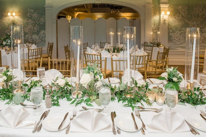 White Taper Candles in Glass Hurricanes Wedding Centerpieces: Modern Garden Inspired Wedding at the Pittsburgh Golf Club from Palermo Photography featured on Burgh Brides