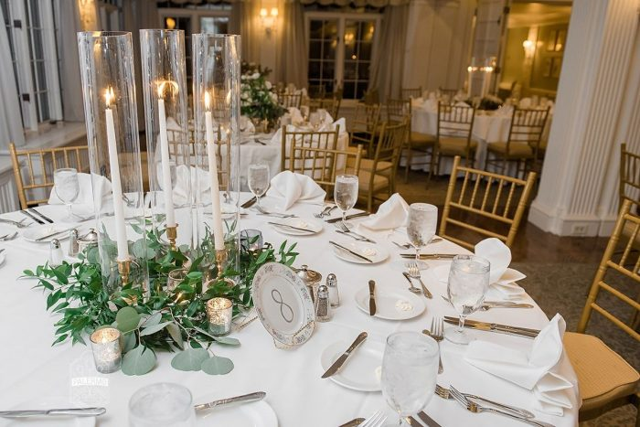 White Taper Candles in Glass Hurricanes at Wedding: Modern Garden Inspired Wedding at the Pittsburgh Golf Club from Palermo Photography featured on Burgh Brides