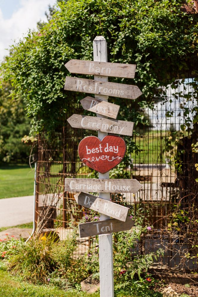 Wooden Wedding Signs: Vintage Rustic Wedding at Shady Elms Farm from Steven Dray Images featured on Burgh Brides