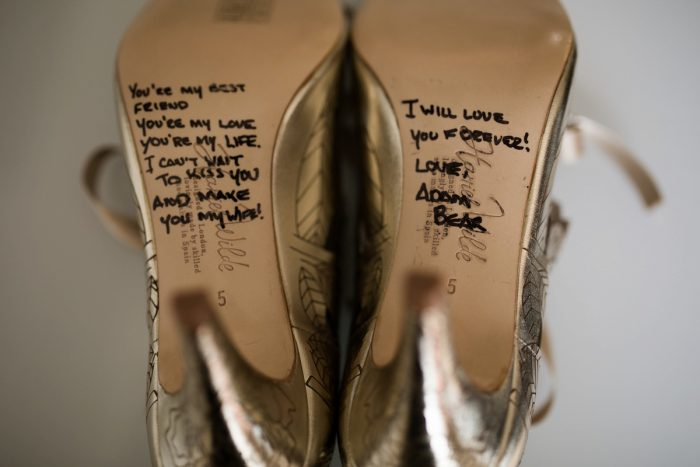 Love note written on bottom of wedding shoes: Berry & Dusty Blue Wedding at the Duquesne Power Center from Tara Bennett Photography featured on Burgh Brides