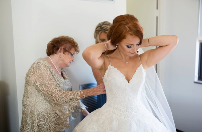 Bride Getting Ready on Wedding Day: Berry & Dusty Blue Wedding at the Duquesne Power Center from Tara Bennett Photography featured on Burgh Brides
