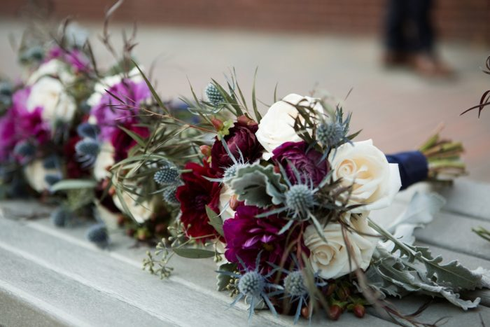 Bridesmaids Bouquet with Blue Thistle: Berry & Dusty Blue Wedding at the Duquesne Power Center from Tara Bennett Photography featured on Burgh Brides