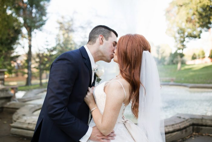 Bride and Groom Kissing: Berry & Dusty Blue Wedding at the Duquesne Power Center from Tara Bennett Photography featured on Burgh Brides