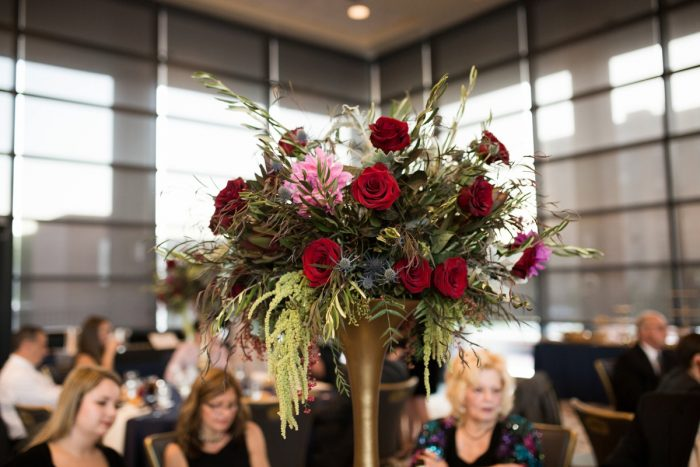 Elevated Wedding Centerpieces on Gold Stands: Berry & Dusty Blue Wedding at the Duquesne Power Center from Tara Bennett Photography featured on Burgh Brides