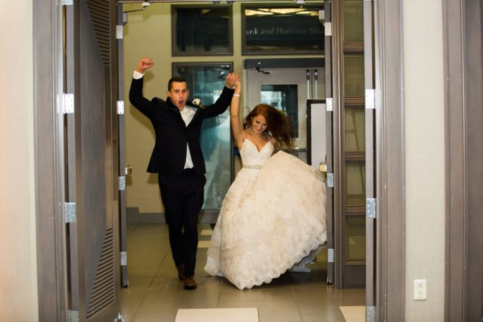 Bride and Groom Entrance: Berry & Dusty Blue Wedding at the Duquesne Power Center from Tara Bennett Photography featured on Burgh Brides
