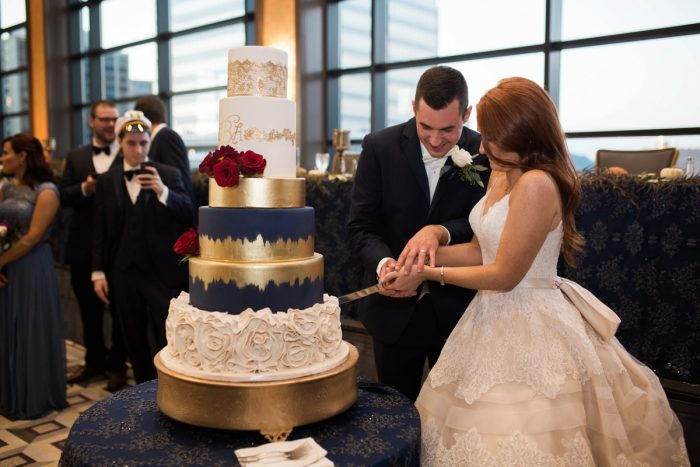 Wedding Cake Cutting: Berry & Dusty Blue Wedding at the Duquesne Power Center from Tara Bennett Photography featured on Burgh Brides