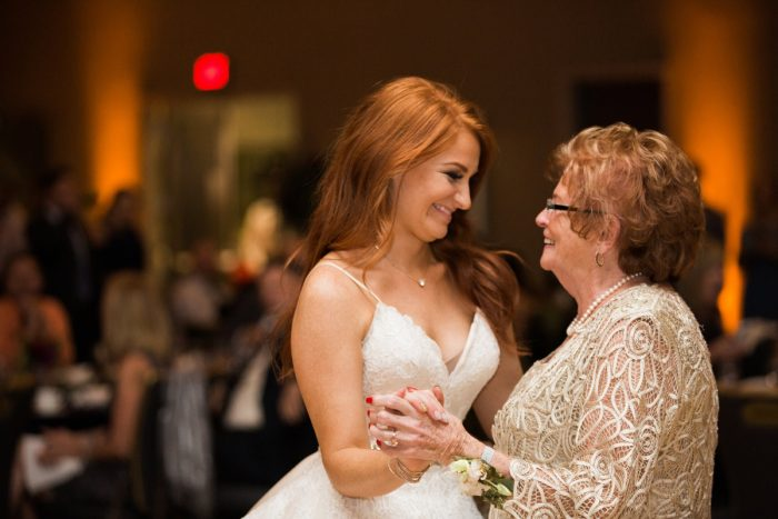 Bride dancing with grandmother: Berry & Dusty Blue Wedding at the Duquesne Power Center from Tara Bennett Photography featured on Burgh Brides