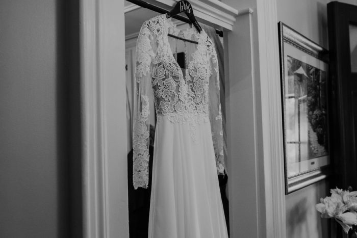 Long Lace Sleeve Wedding Dress: Boho Jewel Tone Wedding at Bramblewood from Tied & True Photography featured on Burgh Brides