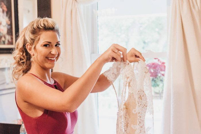 Bridesmaids Holding Wedding Dress: Boho Jewel Tone Wedding at Bramblewood from Tied & True Photography featured on Burgh Brides