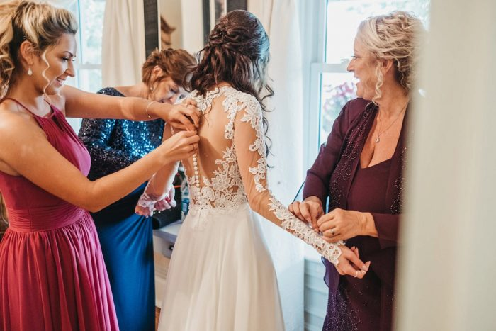 Bride Getting Ready on Wedding Day: Boho Jewel Tone Wedding at Bramblewood from Tied & True Photography featured on Burgh Brides