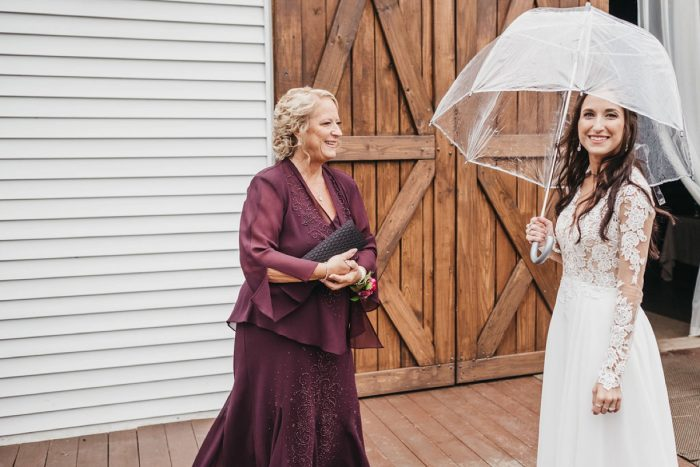 Umbrella on Rainy Wedding Day: Boho Jewel Tone Wedding at Bramblewood from Tied & True Photography featured on Burgh Brides