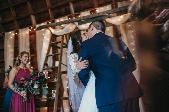 Bride and Groom Kiss: Boho Jewel Tone Wedding at Bramblewood from Tied & True Photography featured on Burgh Brides