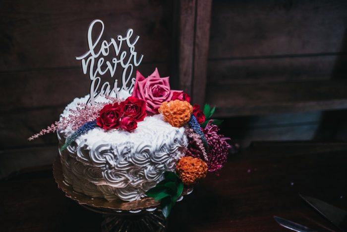Wooden Wedding Cake Topper: Boho Jewel Tone Wedding at Bramblewood from Tied & True Photography featured on Burgh Brides
