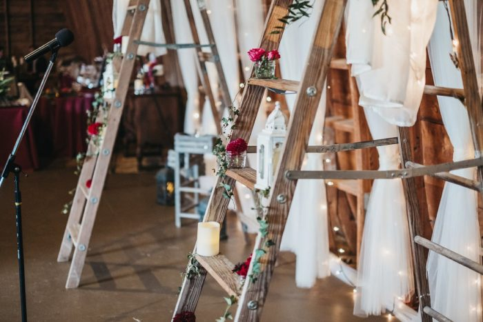 Wooden Ladder Display at Wedding: Boho Jewel Tone Wedding at Bramblewood from Tied & True Photography featured on Burgh Brides