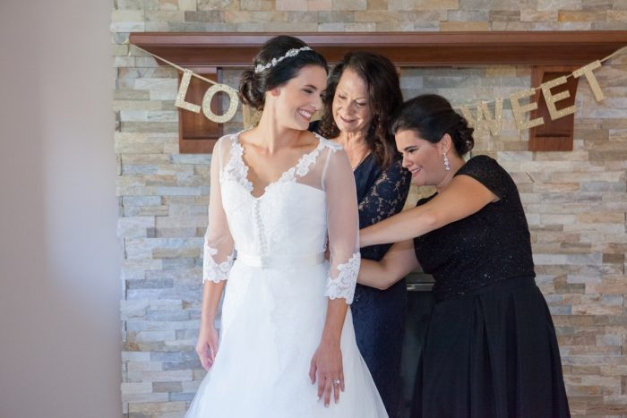 Lace Sleeves Wedding Dress: Elegant Black & White Wedding at Noah's Event Venue: Mallory & Mark