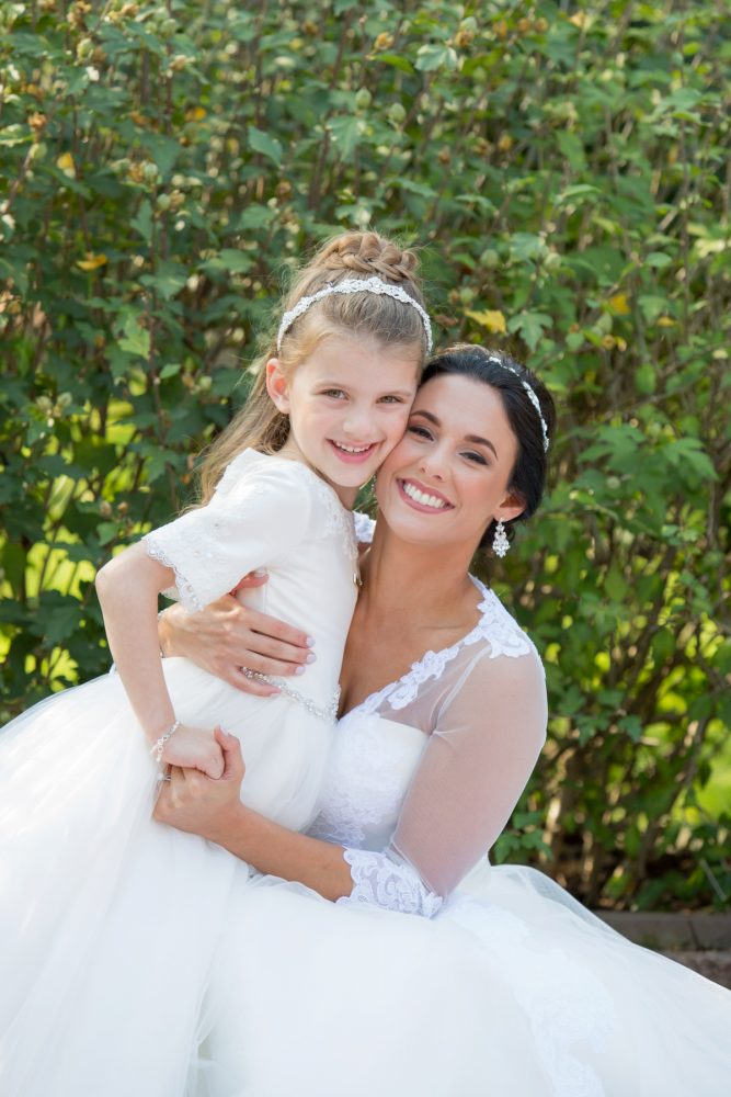 Bride and Flower Girl: Elegant Black & White Wedding at Noah's Event Venue: Mallory & Mark