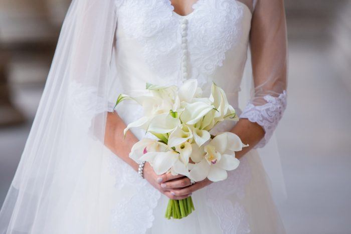 Orchid and Lily Bridal Bouquet: Elegant Black & White Wedding at Noah's Event Venue: Mallory & Mark