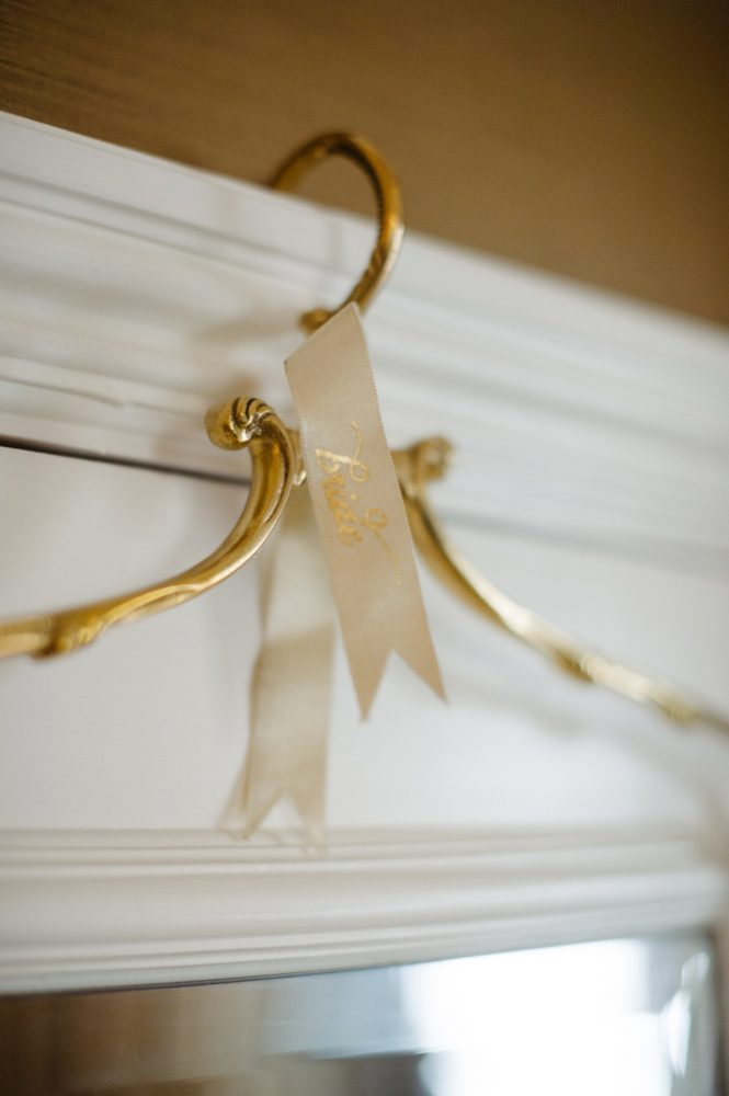 Gold Wedding Dress Hanger: Flawless Gold & White Wedding at Fox Chapel Golf Club from Michael Will Photography featured on Burgh Brides