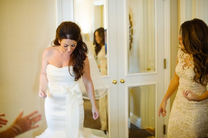 Fit and Flare Wedding Dress with Bow Sash: Flawless Gold & White Wedding at Fox Chapel Golf Club from Michael Will Photography featured on Burgh Brides
