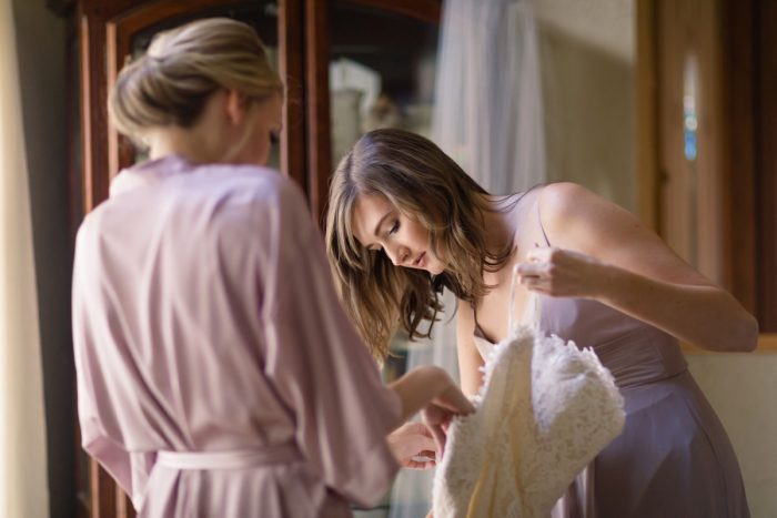 Bride Getting Dressed: Greenery Inspired Wedding at the Butler Country Club from Kristen Wynn Photography featured on Burgh Brides