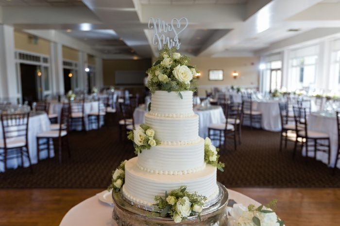 Buttercream Wedding Cake with Fresh Flowers: Greenery Inspired Wedding at the Butler Country Club from Kristen Wynn Photography featured on Burgh Brides