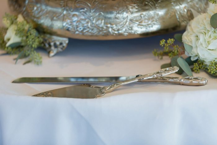 Antique Wedding Cake Knives: Greenery Inspired Wedding at the Butler Country Club from Kristen Wynn Photography featured on Burgh Brides