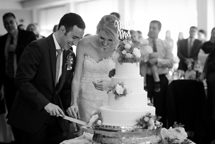 Wedding Cake Cutting: Greenery Inspired Wedding at the Butler Country Club from Kristen Wynn Photography featured on Burgh Brides
