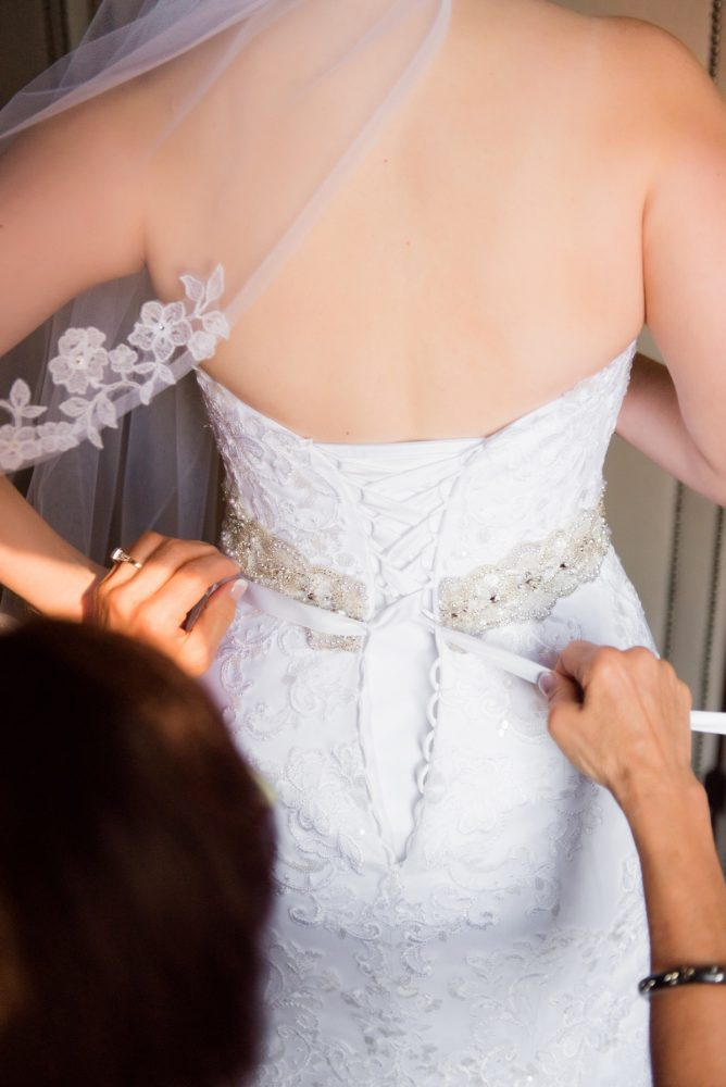 Corset Back Wedding Dress: Old World Romance Wedding at the Omni William Penn Hotel from Leeann Marie Wedding Photographers featured on Burgh Brides