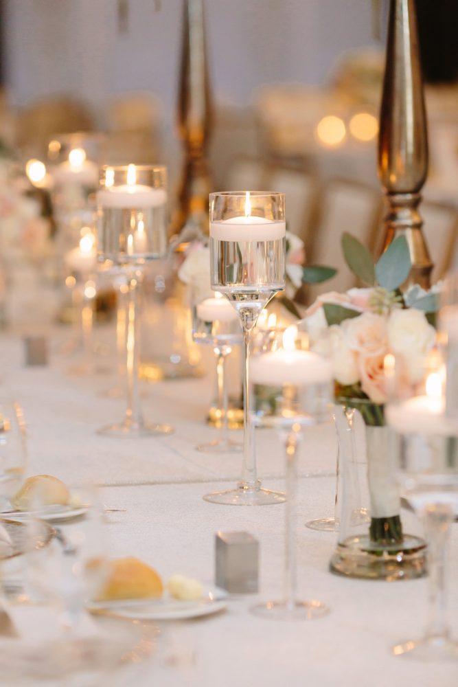 Floating Candles Wedding Centerpieces: Soft & Chic Wedding at Hotel Monaco from Jeannine Bonadio Photography featured on Burgh Brides