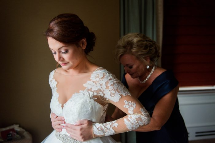 Lace Sleeve Wedding Dress: Sophisticated Merlot Wedding at the Omni William Penn Hotel from Leeann Marie, Wedding Photographers featured on Burgh Brides