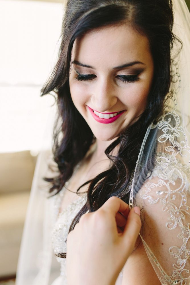 Bright Lipstick on Bride for Wedding Day: Sparkly Gold Wedding at Longue Vue Club from Jeannine Bonadio Photography featured on Burgh Brides