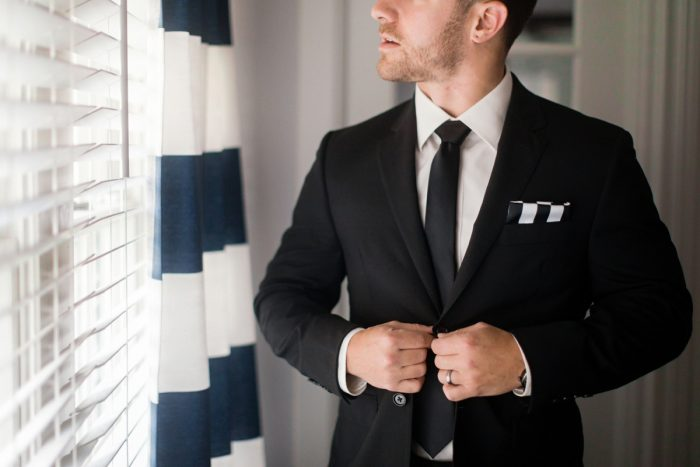 Groom Suit: Elegant Striped Wedding at the Wyndham Grand Pittsburgh from Kristen Wynn Photography featured on Burgh Brides