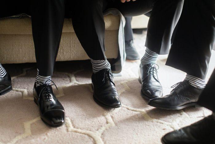 Groomsmen Socks: Elegant Striped Wedding at the Wyndham Grand Pittsburgh from Kristen Wynn Photography featured on Burgh Brides