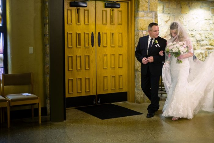 Bride Walking Down Aisle: Elegant Striped Wedding at the Wyndham Grand Pittsburgh from Kristen Wynn Photography featured on Burgh Brides