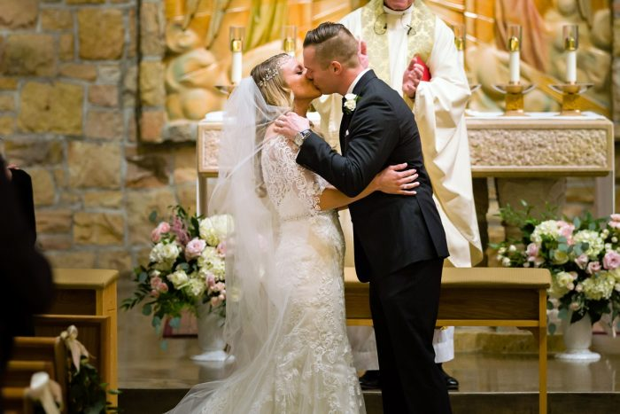 Bride and Groom Kiss: Elegant Striped Wedding at the Wyndham Grand Pittsburgh from Kristen Wynn Photography featured on Burgh Brides
