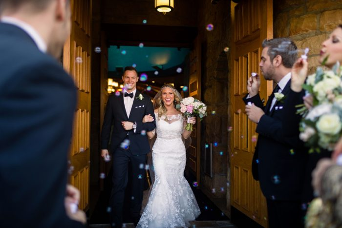 Wedding Ceremony Bubble Exit: Elegant Striped Wedding at the Wyndham Grand Pittsburgh from Kristen Wynn Photography featured on Burgh Brides