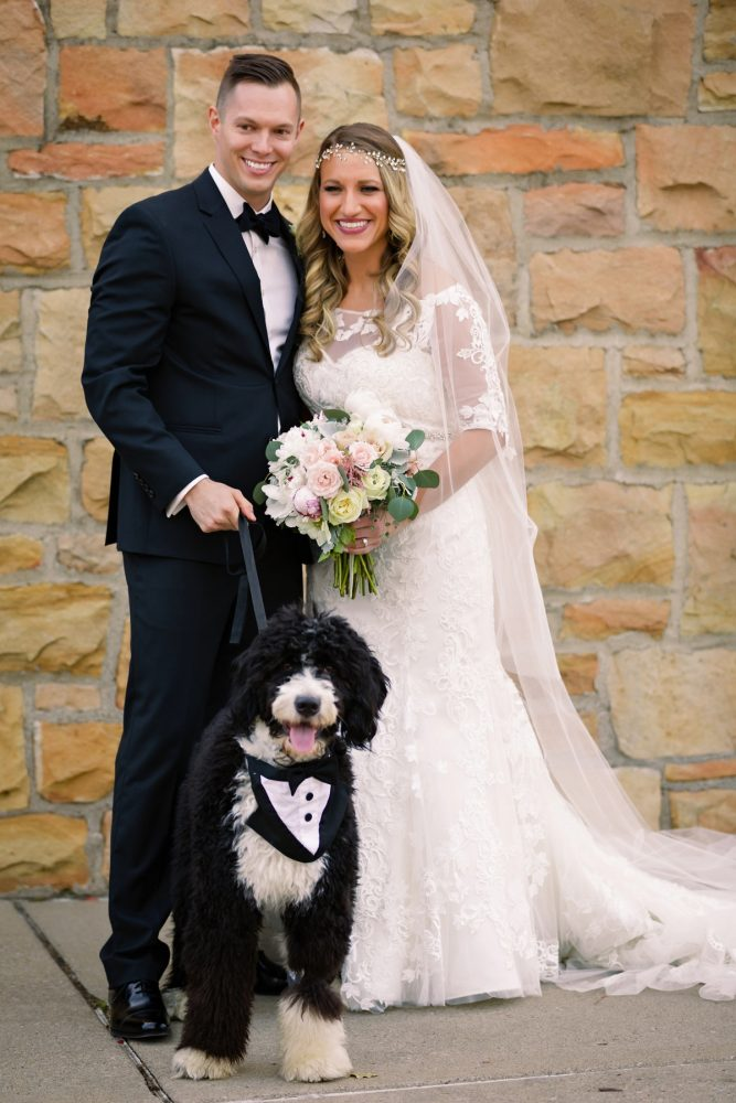 Bride and Groom with Dog: Elegant Striped Wedding at the Wyndham Grand Pittsburgh from Kristen Wynn Photography featured on Burgh Brides