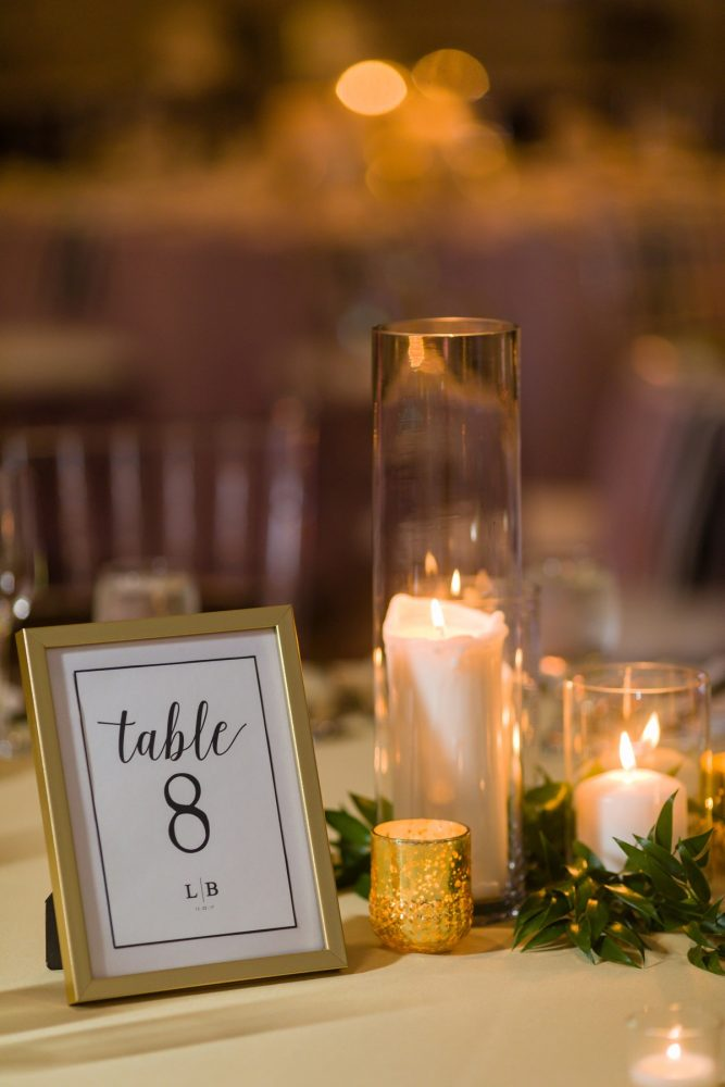 Candle Wedding Centerpieces: Elegant Striped Wedding at the Wyndham Grand Pittsburgh from Kristen Wynn Photography featured on Burgh Brides