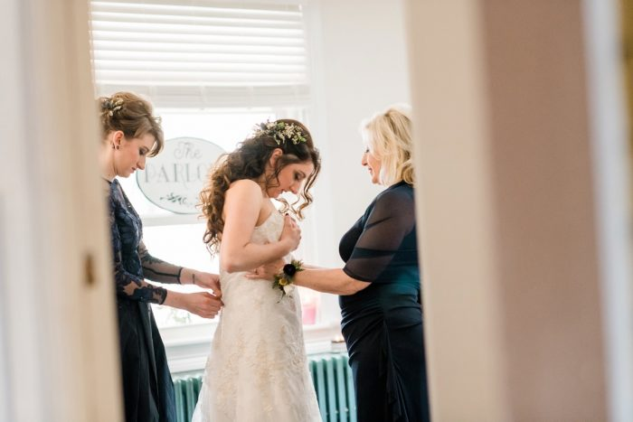 Bride getting ready: Enchanting Forest Inspired Wedding from Dawn Derbyshire Photography featured on Burgh Brides