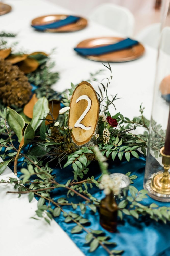 Wooden Wedding Table Numbers: Enchanting Forest Inspired Wedding from Dawn Derbyshire Photography featured on Burgh Brides