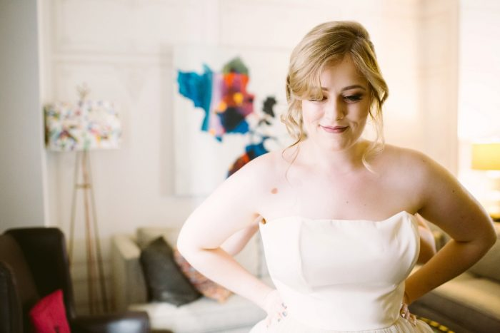 Loose Bridal Updo: Small Eclectic Wedding at Smallman Galley from Caitlin Thomas Photography featured on Burgh Brides