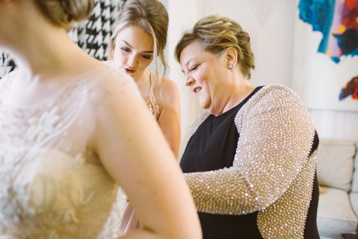 Bride Getting Dressed: Small Eclectic Wedding at Smallman Galley from Caitlin Thomas Photography featured on Burgh Brides