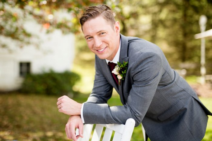 Groom in Gray Suit: Vivid Fall Wedding at Shady Elms Farm from Jenna Hidinger Photography featured on Burgh Brides