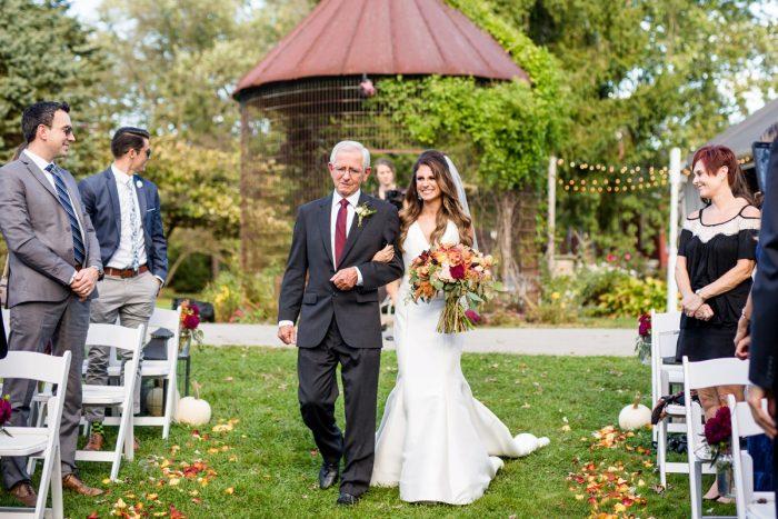 Bride Walking Down Aisle: Vivid Fall Wedding at Shady Elms Farm from Jenna Hidinger Photography featured on Burgh Brides