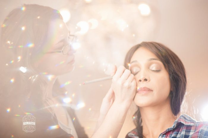 Bridesmaid Getting Makeup Done: Blowouts, Bubbly, & Brunch Bridal Shower Inspiration from Jessica Garda Events and Palermo Photography featured on Burgh Brides