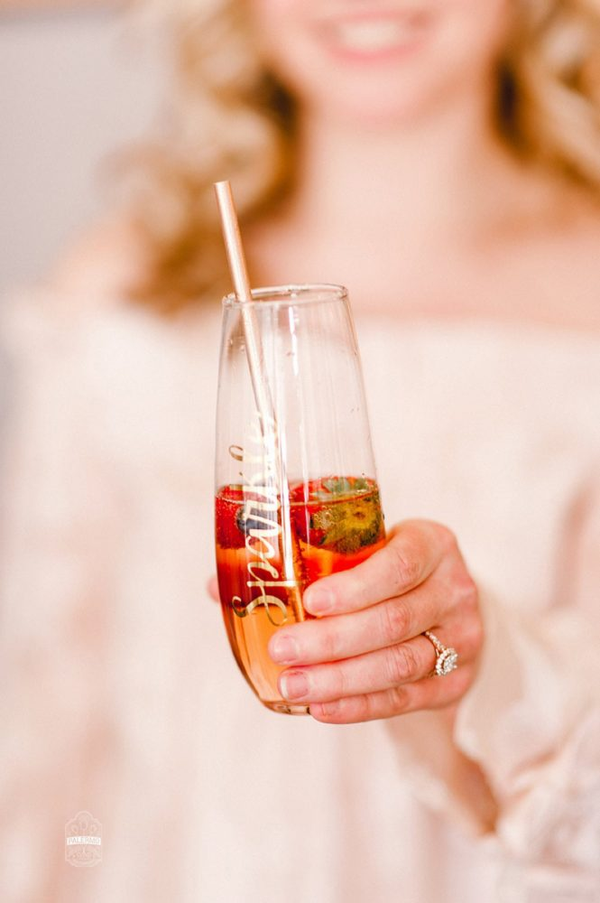 Bridesmaid Holding Champagne Glass with Gold Calligraphy: Blowouts, Bubbly, & Brunch Bridal Shower Inspiration from Jessica Garda Events and Palermo Photography featured on Burgh Brides